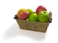 Free Isolated Straw Basket With Apples Royalty Free Stock Photos - 4343318