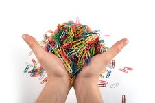 Hands Full Of Paper Clips 2 Stock Images