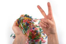 Hands Holds Paper Clips And Gives Gesture 4 Royalty Free Stock Photo