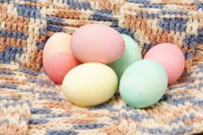 Colored Eggs On Crochet Stock Image