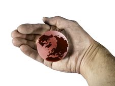 Hand Enclosing Red Globe Stock Photography