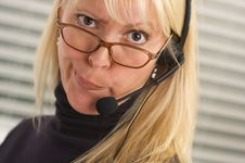 Attractive Businesswoman With Phone Headset Stock Photos