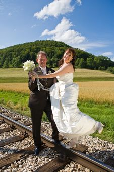 Bridal Couple On Rails Royalty Free Stock Photos