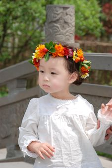 Free Beautiful Child With A Coronet Of Flowers Royalty Free Stock Photography - 4351457