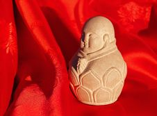 Free Chinese Stone Buddha Carving On Red Silk Stock Photos - 4356453