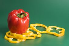 Free Red And Yellow Peppers Over Green Background Royalty Free Stock Photography - 4364357