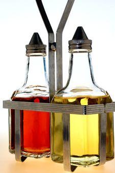 Free Oil And Vinegar Bottles In Metal Rack Stock Image - 4364501