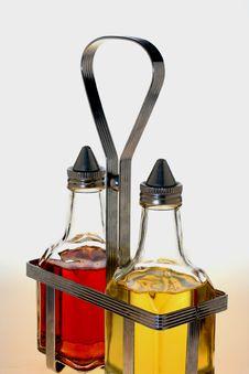 Free Oil And Vinegar Bottles In Metal Rack Stock Photography - 4364542