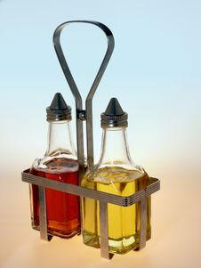 Free Oil And Vinegar Bottles In Metal Rack Royalty Free Stock Image - 4364606