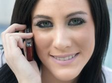 Free Attractive Young Woman Using Cell Phone Stock Photography - 4374992
