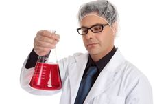 Free Chemist Carrying Large Flask Stock Photo - 4377870