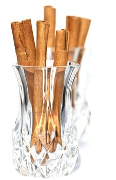 Cinnamon Sticks In  Crystal Glass Stock Photo
