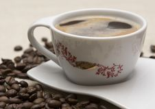 Cup Of Coffee And Grains Royalty Free Stock Photography