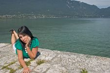 Free Woman Lengthened At The Edge Of A Lake Stock Photo - 4380600