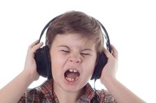 Free The Little Boy Listens To Music Stock Photo - 4383880