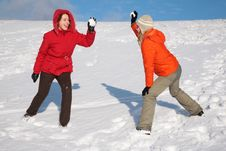 Free Two Young Women Play To Snowballs Stock Photo - 4386720