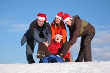 Free Three Friends Push Girl On Sled Royalty Free Stock Photos - 4386928