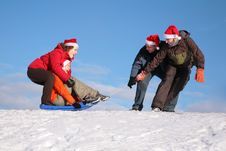 Free Two Men Pull Two Women On Sled Royalty Free Stock Photography - 4386997