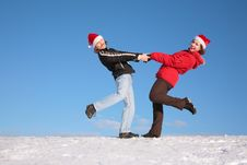 Free Couple Dance On  Snow Hill In Santa Claus Hats 2 Royalty Free Stock Photos - 4387098