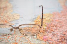 Free Glasses On Map Stock Photography - 4387692