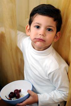 Free Little Boy Eating Cherries Stock Image - 4389791