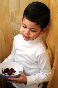 Free Little Boy Eating Cherries Stock Photo - 4389800