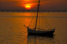 Free River Boat By Sunset Royalty Free Stock Photos - 4390598