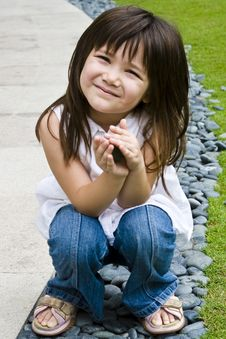 Free Smiling Girl Playing With Stones Stock Photo - 4390850