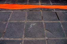 Free Orange Monks Robe On Stone Floor Stock Photography - 4391912