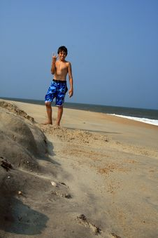 Free Boy Standing On Beach Royalty Free Stock Image - 4395876