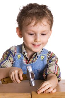 Free Kid Hammers A Hammer In Nails Stock Photography - 4396422