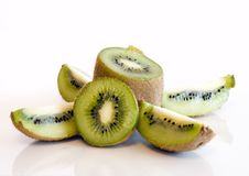 Colorful Kiwi Fruit Whole And Cut By Four Pieces Stock Photo