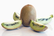 Colorful Kiwi Fruit Whole And Cut By Four Pieces Royalty Free Stock Images