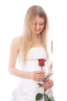 Free Young Smiling Bride Look To Red Rose Royalty Free Stock Photography - 4397507