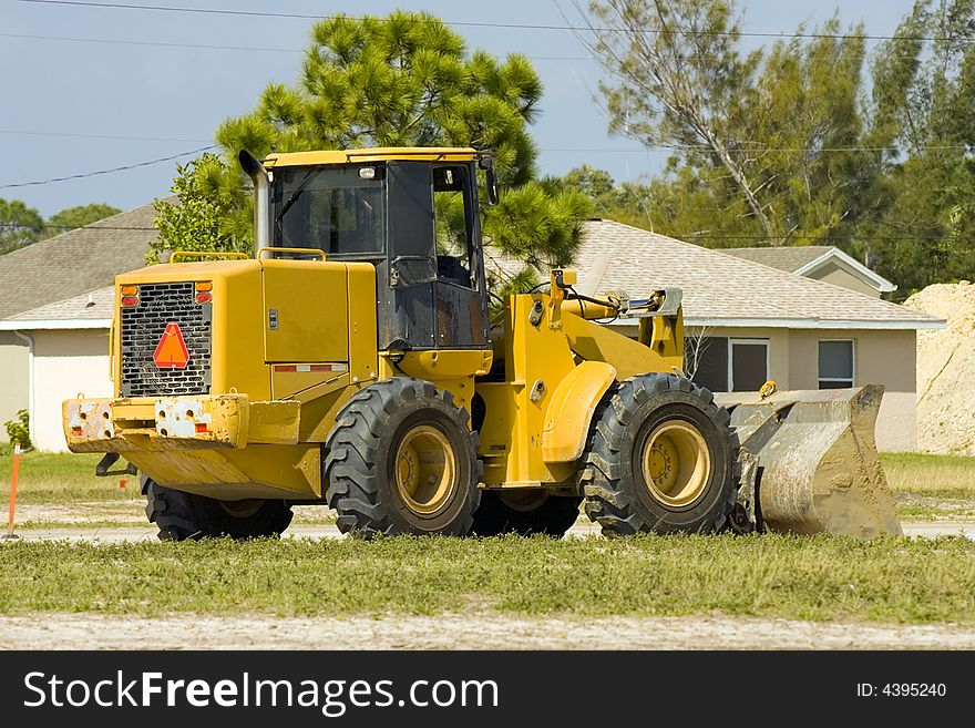 A front end loader sits idle