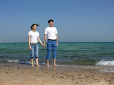 Couple Stand. Faces. Sea. Stock Photo