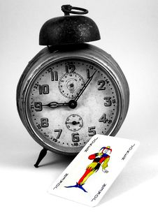 Free Old Clock And A Joker Card Stock Image - 448031