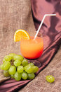 Free Cocktail Of Orange Juice With A Grape Branch Royalty Free Stock Photos - 4402638