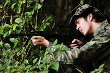 Free Soldier In Bushes Taking Aim Stock Images - 4401184