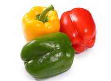 Free Red, Yellow And Green Paprika On White Royalty Free Stock Photography - 4401407