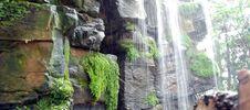 Waterfall Cascading Over Wet Rocks Stock Photos