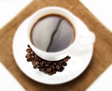 Free Coffee Cup With Beans Stock Photography - 4401642