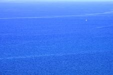 Free A White Sailboat On The Blue Water Stock Photos - 4402713