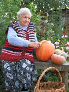 Grandma With Pumpkins Royalty Free Stock Images