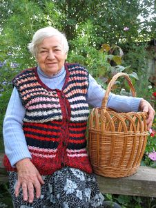Free Grandmother With Basket Stock Image - 4404421
