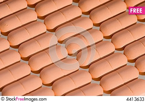 Free Rows Of Pink Pills Over White Stock Photos - 4413633