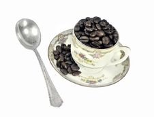 Coffee Beans In An Antique Cup Stock Images