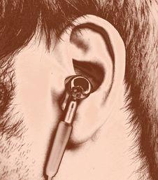 Free Ear With Earphone. Stock Image - 4413061