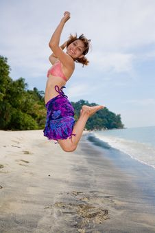 Jumping Freely At The Beach Royalty Free Stock Image