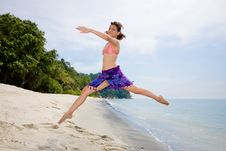 Free Jumping Freely At The Beach Royalty Free Stock Photography - 4413297